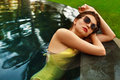 Beautiful woman in swimwear relaxing in swimming pool summer vacations healthy sexy girl with fit body fashionable elegant yellow Royalty Free Stock Images