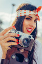 Beautiful woman taking photo with old fashioned film camera Royalty Free Stock Photo