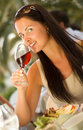 Beautiful woman tasting red wine at restaurant Stock Image