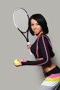 Beautiful woman with tennis racket the a Royalty Free Stock Photography