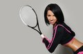 Beautiful woman with tennis racket the a Stock Image