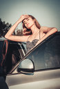 Beautiful woman tired after car driving and stoped for take a rest Royalty Free Stock Photos