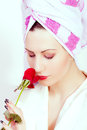 Beautiful woman with a towel around her head portrait of Stock Images