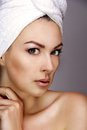 Beautiful woman with a towel on his head on grey background Stock Photography