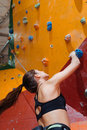 Beautiful woman training hard in climbing gym Royalty Free Stock Photo