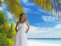 Beautiful woman on tropical beach Stock Photo