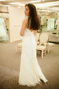 Beautiful woman trying a white bridal wedding dress before getting married Stock Photo