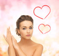 Beautiful woman with updo health and beauty concept face and hands of Royalty Free Stock Image
