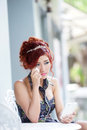 Beautiful woman upset and crying she using smartphone listen melancholic music or get unhappy phone call while sitting at outdoor Stock Photography