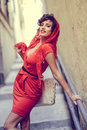 Beautiful woman in urban background vintage style portrait of a pretty wearing a red dress Stock Photos
