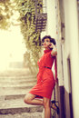 Beautiful woman in urban background vintage style portrait of a pretty wearing a red dress Royalty Free Stock Photos