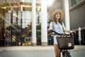 Beautiful woman using bike Royalty Free Stock Photo