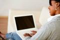 Beautiful woman using laptop while is sitting Stock Photo