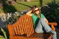 Beautiful woman waiting at the park (horizontal) Stock Photography