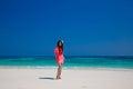 Beautiful woman walking on exotic beach, brunette girl model in Royalty Free Stock Photo