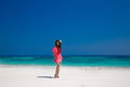 Beautiful woman walking on exotic beach, brunette girl model in Royalty Free Stock Photo
