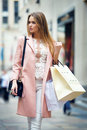 Beautiful woman walking on new york street with bags after she shopping city Royalty Free Stock Image