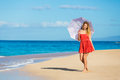 Beautiful Woman Walking on Tropical Beach Royalty Free Stock Photography