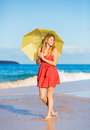Beautiful Woman Walking on Tropical Beach Stock Photo
