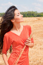 Beautiful woman walking on wheat field Stock Photography