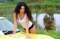 The beautiful woman washes the car Royalty Free Stock Photo