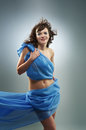 Beautiful woman in waving fabric portrait of young dancing girl Stock Photos