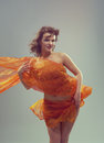Beautiful woman in waving fabric portrait of young dancing girl Royalty Free Stock Images