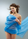 Beautiful woman in waving fabric portrait of young dancing girl Stock Photography