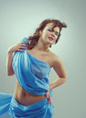 Beautiful woman in waving fabric portrait of young dancing girl Royalty Free Stock Photo