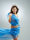 Beautiful woman in waving fabric portrait of young dancing girl Stock Images