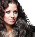 Beautiful woman wearing furs Stock Photos