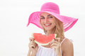 Beautiful woman wearing pink sunhat smiling and eating watermelo Royalty Free Stock Photo