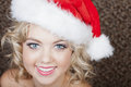 Beautiful Woman wearing a Santa Hat Stock Photography