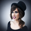 Beautiful woman wearing a top hat portrait of young elegant Stock Photo