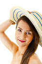 Beautiful woman on white background with long hair and hat look Royalty Free Stock Image