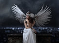 Beautiful woman in white dress with angel wings on a background Royalty Free Stock Photo