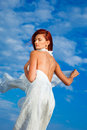 Beautiful woman  in white on seacoast Royalty Free Stock Image