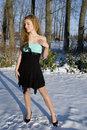 Beautiful woman in the winter blond snow Royalty Free Stock Photography
