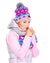 Beautiful woman in winter clothes warming her hands young Royalty Free Stock Photo