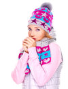Beautiful woman in winter clothes warming her hands young Stock Images