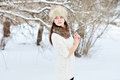Beautiful woman in the winter scenery outdoors Stock Image