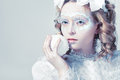 Beautiful woman with winter style makeup closeup portrait of frozen window Royalty Free Stock Photo