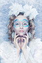 Beautiful woman with winter style makeup ice and snow Royalty Free Stock Photography