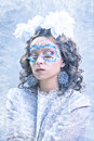 Beautiful woman with winter style makeup ice and snow false eyelashes Royalty Free Stock Photography