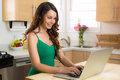 Beautiful woman working at home on laptop casual writer blogger Royalty Free Stock Photo
