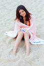 Beautiful woman wrapped herself with blanket on the beach young Stock Image
