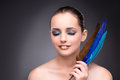 The beautiful woman with writing feather quill Royalty Free Stock Photo
