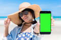 Beautiful woman x s hand using smart phone at beach smartphone green screen beach from thailand asia holding Royalty Free Stock Images