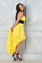 Beautiful woman in yellow evening dress. Stock Photography