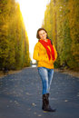Beautiful woman in the yellow park scenery Royalty Free Stock Images